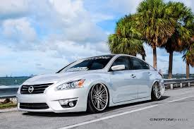 stanced nissan altima jaw dropping white pearl debadged nissan altima customized to amaze