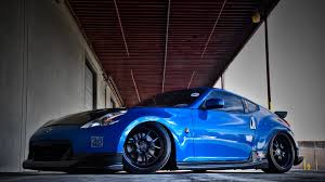 nissan 370z nismo wallpaper blue custom nissan 370z ground level photo wide hd wallpaper