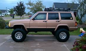 tan jeep cherokee 1999 jeep cherokee 7 000 possible trade 100329534 custom lifted