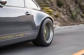 porsche singer engine driving the 1990 porsche 911 reimagined by singer vehicle design