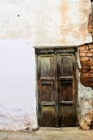 old closed wooden door and white wall download links free