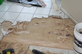 removing porcelain tile on stapled and glued subfloor flooring