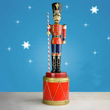 life sized toy soldier with baton on drum 107
