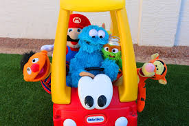 cookie monster driving cozy coupe with super mario sesame street