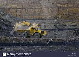 volvo site cat 375 excavator and volvo dumper truck heavy machinery working