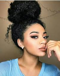 curly hair in high bun with bang natural and curly hair favorites the messy bun more sexy looks