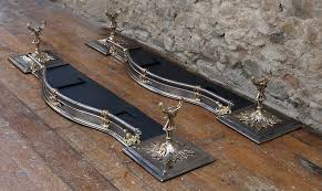 a superb pair of steel and bronze fireplace fenders