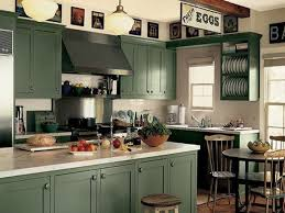 painted green kitchen cabinets with light counter tops painted