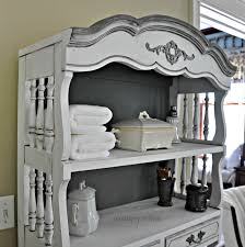 handsome french open cabinetry storage in soft grey painted as