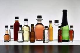 alcoholic drinks bottles essential liquors and mixers to stock in your home bar