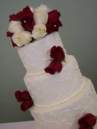 wedding cake 4 tier buttercream fresh red and white roses the