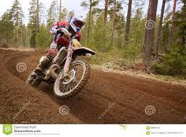 motocross race tracks motocross driver accelerating the motorbike on the race track