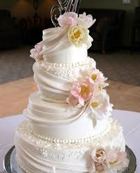 fondant wedding cakes 4 tier cake fondant draping with fresh flowers unforgettable