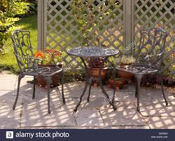 ornate grey green painted aluminium table and chairs with