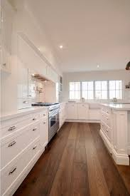 white kitchen flooring ideas 20 gorgeous exles of wood laminate flooring for your kitchen