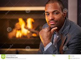 handsome black man by fireplace royalty free stock photo image