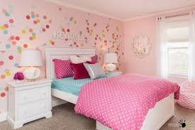 pretty pink wall with colorful circles decals and lovely flower
