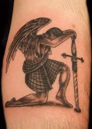 angel n demon tattoo with cross on back real photo pictures