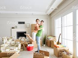 couple celebrating moving in to a new home stock photo 491446124