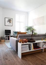 living room sofa and bookcase creates a room within a room the