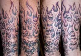 ace spades design arm flaming skull half sleeve