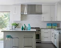 New Caledonia Granite Countertops And White Glass Tile Backsplash - White glass tile backsplash