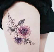collection of 25 flowers tattoos on thigh