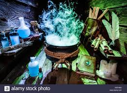 mysterious witch pot with blue and green smoke for halloween stock