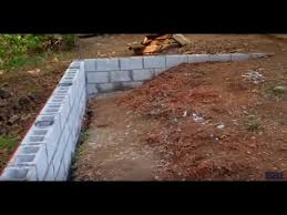constructing a retaining wall youtube