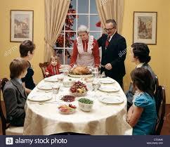 1970s three generation family thanksgiving dinner stock