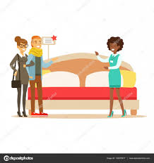 store seller demonstrating king size bed to couple smiling