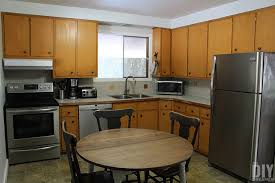 what paint to use on melamine kitchen cabinets how to paint kitchen cabinets budget friendly kitchen makeover
