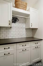Estate Storage Cabinets Altadore One Laundry Room Veranda Estate Homes Inc Veranda