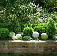 stone garden balls garden decoration ideas colorful painted