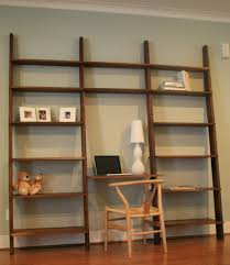 leaning book shelf with optional computer desk in walnut by cubb