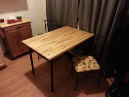 diy making an awesome pallet table with enough patience and sweat you can turn some old wooden pallets into an awesome butcher block table with some pretty amazing results