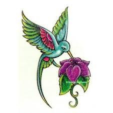 Hummingbird On A Flower - free hummingbird tattoos of humming bird hummingbird tattoo