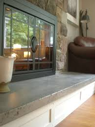 custom made concrete hearth and custom mantel fireplace