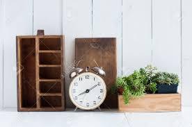 vintage home decor old wooden boxes houseplants alarm clock
