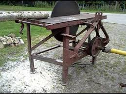 bench for circular saw tractor pto driven circular saw bench being driven by grey fergie