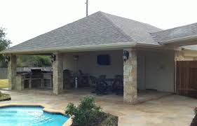 patio cover and outdoor kitchen off garage texas custom patios