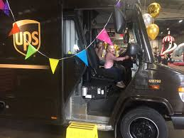 ups family day with a branded delivery vehicle complete