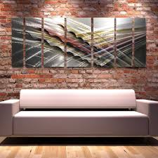 shock wave contemporary metal art panels on brick wall