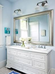 vanity in this serene bathroom filled with vintage touches