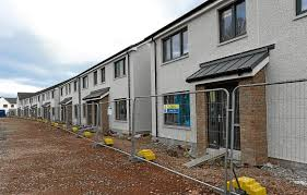 build on site homes first tenants to move into homes build on site of city s former jail
