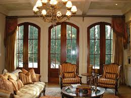 arched french door with luxurious classic drapes window treatment