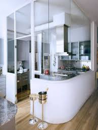 small kitchen design layout with grey cabinets and silver hood and