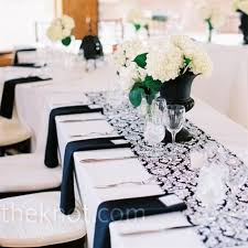 black and white wedding decorations i like the black vases but i would put more hydrangeas in the vase