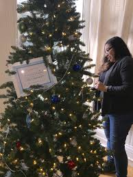 artificial christmas tree giveaway with christmas in the community