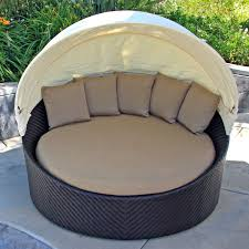 exterior round wicker daybed with curved canopy tent and brown source